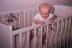 Happy Baby In Crib (1964 - Vintage 8mm footage) - stock footage