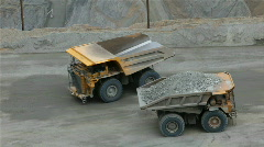 Mining dump trucks passing P HD 0290 Stock Footage