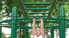 Boy falling while going across Monkey Bars Stock Footage