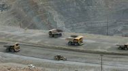 Mine trucks and graders in mountain pit Kennecott P HD 0288 Stock Footage