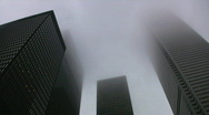 Stock Video Footage of Misty skyscrapers. Timelapse effect applied.