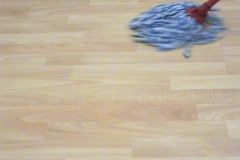 Mopping Hardwood Floor (Right to Left High Angle) Stock Footage