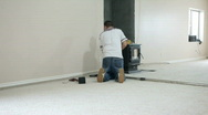 Carpet install stretch white room P HD 0249 Stock Footage