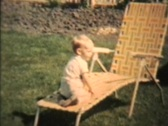 Boy Plays With Garden Hose 1963 (Vintage 8mm film footage) Stock Footage