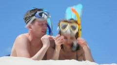 Pair of swimmers dresses masks Stock Footage