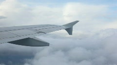 Plane wing over clouds Stock Footage