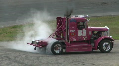 Motorsports, Big Rig racing, diesel truck donut burnout! Stock Footage