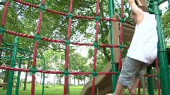 Boy climbing on Play Equipment - stock footage