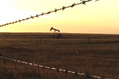 Lonely Oil Well In The Prairies At Dusk Stock Footage