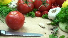 Slicing juicy tomatoes Stock Footage