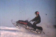 Snowmobiling Jumps (1975 - Vintage 8mm film) Stock Footage