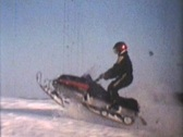 Stock Video Footage of Snowmobiling Jumps (1975 - Vintage 8mm film)