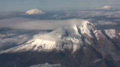 Cayambe Volcano in the Ecuadorian Andes viewed from the air  Stock Footage
