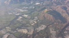 Aerial view of flower farm greenhouses Stock Footage
