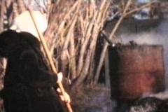Burning Leaves In The Backyard (1975 - Vintage 8mm footage) Stock Footage