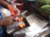 Fresh Papaya Being Cut Up By Street Vendor Stock Footage