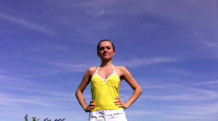 Young woman doing active exercises against the blue sky - stock footage