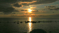 Vivid sunset over a calm Baltic sea in Sweden - stock footage