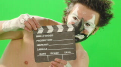 Stock Video Footage of Clown with clapboard 2