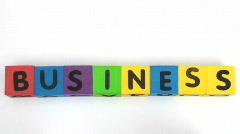 Building blocks spell Business Stock Footage