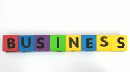 Stock Video Footage of Building blocks spell Business