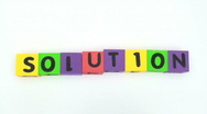 Stock Video Footage of Building blocks spell SOLUTION