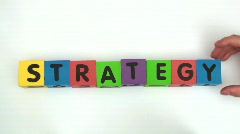 Building blocks spell STRATEGY Stock Footage