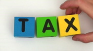Stock Video Footage of Building blocks spell TAX