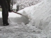 Stock Video Footage of Shoveling Light Fluffy Snow