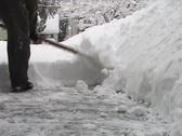 Shoveling Light Fluffy Snow Stock Footage