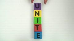 Building blocks spell UNITE Stock Footage