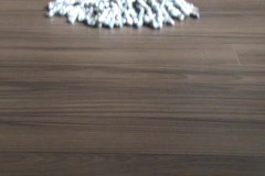 Mopping Laminate Flooring (Center view - with end lift) Stock Footage