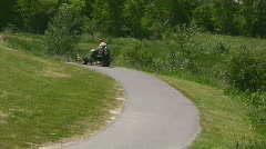 Golf Course Lawn Tractor Driving On A Cart Path Stock Footage