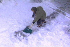 Guy slips shoveling snow Stock Footage