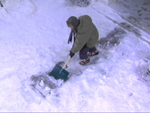 Stock Video Footage of Guy slips shoveling snow