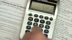 Filing income taxes time lapse - HD  Stock Footage