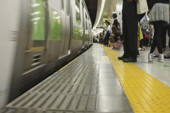 Boarding a train in a Tokyo station Stock Footage