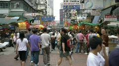 China Hong Kong Chinatown crowds Sham Shau Po Apliu open air market Stock Footage