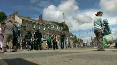 Stock Video Footage of Tourists walk along the quay at Padstow in Cornwall England