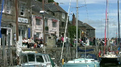 Tourists on the quay at Padstow harbor in Cornwall England Stock Footage