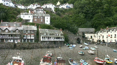 Boats moored in the harbor at Clovelly in Devon England - stock footage