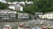 Stock Video Footage of Boats moored in the harbor at Clovelly in Devon England