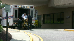 Taking patient out of ambulance - stock footage