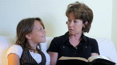Grandmom and granddaughter bible study Stock Footage
