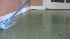 Mopping A Green Floor At Home (HD 1080p30) Stock Footage
