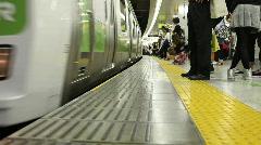 Train boarding in a Shibuya station Stock Footage