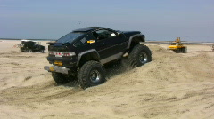 Off-roader monster truck in competition on the beach Stock Footage