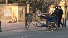 Relaxing Pedicab driver in Central Park Stock Footage