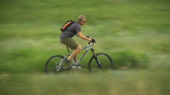 Fitness, mountain bike rider on trail, #3 long lens follow shot Stock Footage