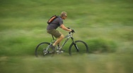 Stock Video Footage of fitness, mountain bike rider on trail, #3 long lens follow shot